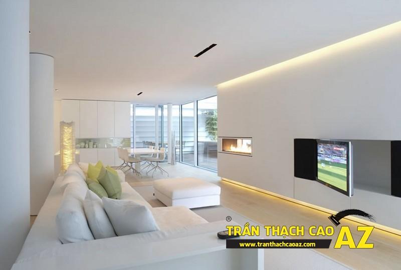 Mẫu trần thạch cao phòng khách đẹp cho căn hộ mini với tạo hình trần phẳng kết hợp giật cấp
