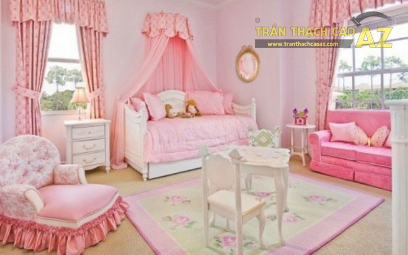 Mẫu trần thạch cao lấy gam hồng làm chủ đạo được thiết kế cho phòng ngủ bé gái